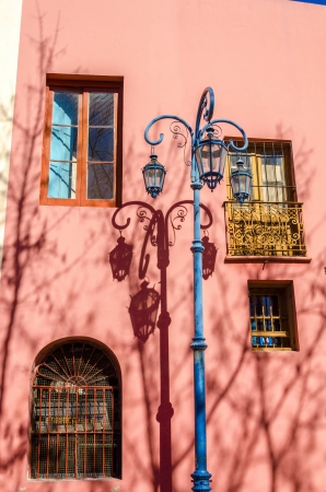 la boca: Blue streetlight in La Boca neighborhood of Buenos Aires next to a pink building Stock Photo