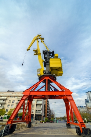 longer: A tall no longer used red and yellow crane in Buenos Aires Stock Photo