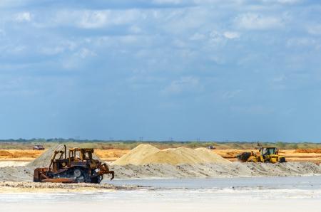 heavy machinery: Heavy machinery gathering salt in Manaure in La Guajira, Colombia Stock Photo