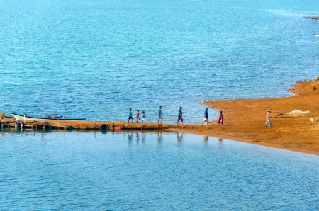 small group of people: Group of people disembarking from small boats in La Guajira, Colombia