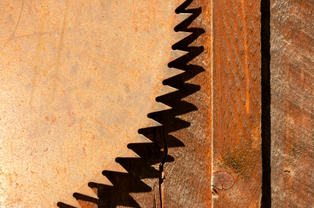 Rusted blade of an old circular saw photo