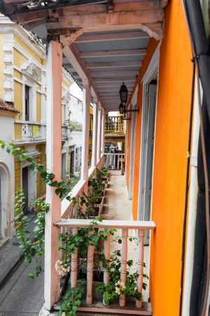 View of orange and white colonial balcony in the historic city of Cartagena, Colombia Stock Photo - 24452441