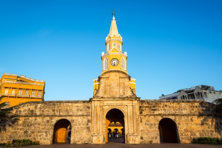 The historic clock tower gate is the main entrance into the old city of Cartagena, Colombia photo