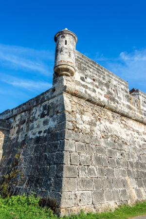 surrounds: Corner of the defensive wall that surrounds the historic center of Cartagena, Colombia