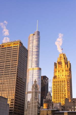 View of several skyscrapers in Chicago with the golden light of an early morning sunrise