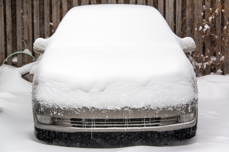 Car covered in several inches of snow in Chicago photo