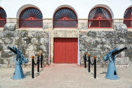 Colonial building in Cartagena, Colombia with two large guns in front of it
