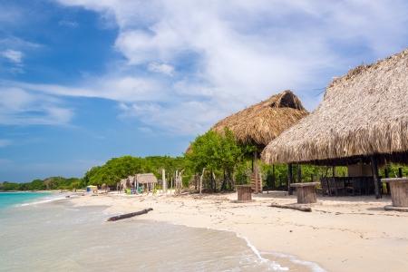 Simple beach huts on beach at Playa Blanca near Cartagena, Colombia
