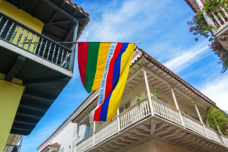 Colonial balconies with a Colombian flag in the historic center of Cartagena, Colombia