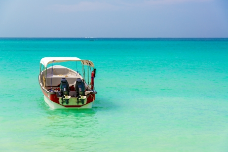 playa blanca: Turquoise Caribbean water as seen from Playa Blanca near Cartagena Colombia with a boat in the foreground Stock Photo