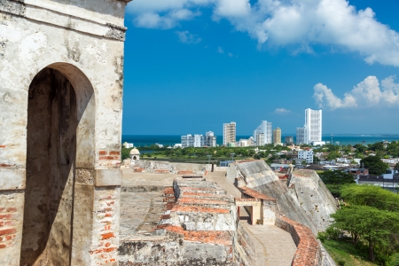 barajas: San Felipe de Barajas castle in Cartagena, Colombia with modern high rise apartment buildings visible in the background Stock Photo