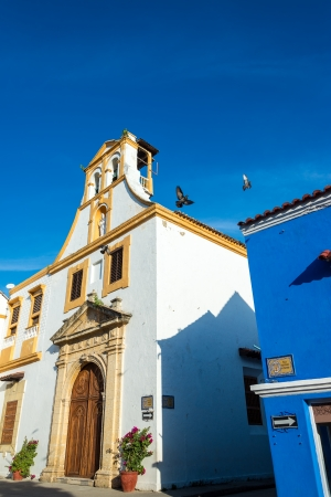 White Colonial Church with a deep blue sky in the historic center of Cartagena, Colombia photo