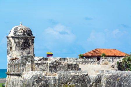 fortify: Defensive wall surrounding the historic center of Colombia with a Colombian flag waving in the breeze