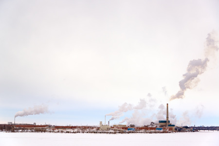Polluting factory in the snow on an overcast day in Green Bay, Wisconsin photo