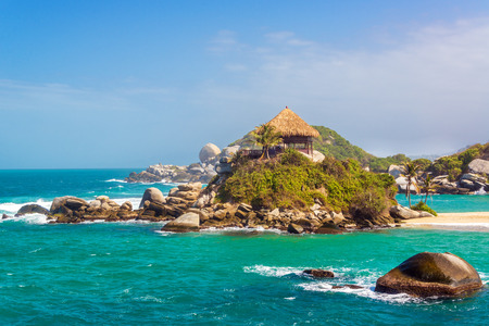 Turquoise water and beach shack at Cabo San Juan del Guia in Tayrona National Park in Colombia