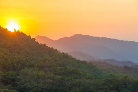 marta: Sun setting over lush green hills in the Sierra Nevada de Santa Marta mountain range in Colombia