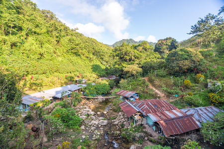 lost city: Rustic shacks in a beautiful valley in the Sierra Nevada de Santa Marta in Colombia