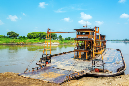 Old historic ferry waiting to take passenger along the Magdalena River to and from Mompox, Colombia Editorial