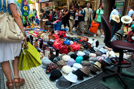 BUENOS AIRES - DECEMBER 22  Shoppers pass by a pedestrian mall in Buenos Aires on December 22, 2011