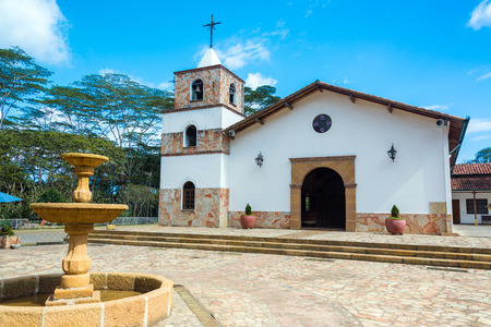 santander: Beautiful white church in Mesa de los Santos in Santander, Colombia with a fountain in the foreground Stock Photo