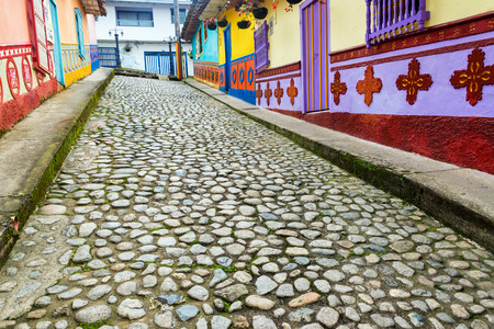Colorful cobblestone street in town of Guatape in Antioquia, Colombia