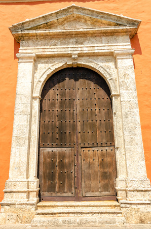 Large wooden door on the front of a church in Cartagena, Colombia photo