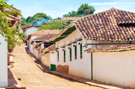 santander: Colonial street with with white historic buildings in Barichara, Colombia
