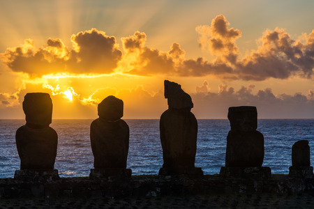 Five moai on Easter Island with the sun setting behind them photo