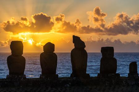 rano raraku: Five moai on Easter Island with the sun setting behind them