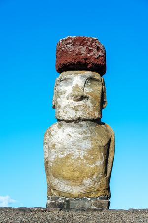 rano raraku: Sine Moai statue on Easter island with a blue sky