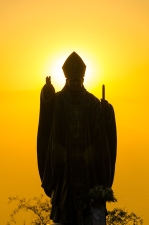 pontiff: Silhouetted statue of Pope John Paul II on Santiago, Chile at sunset Stock Photo