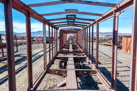 salar: Remains of a train carriage at the Train Cemetery in Uyuni, Bolivia