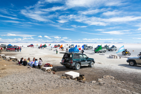 incahuasi: UYUNI, BOLIVIA - JULY 11  Tourists and SUVs seen at the base of Island Incahuasi on the Uyuni Salt Flats in Bolivia on July 11, 2014 Editorial