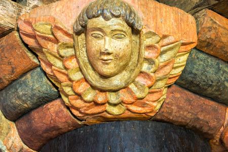 jesuit: View of a cherub  fallen angel  in the UNESCO World Heritage Jesuit Mission in Santa Ana, Bolivia