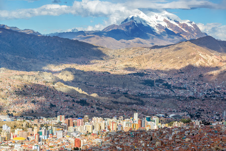 Cityscape of La Paz, Bolivia with Illimani Mountain rising  Stock Photo