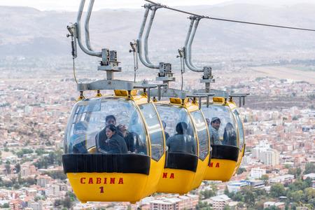 cochabamba: COCHABAMBA, BOLIVIA - AUGUST 8: A cable car takes passengers up to the Cristo de la Concordia statue in Cochabamba, Bolivia on August 8, 2014 Editorial