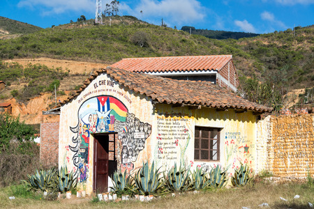 publicly: VALLEGRANDE, BOLIVIA - AUGUST 6: Building with Che Guevara graffiti near the site where his body was publicly displayed in Vallegrande, Bolivia following his death as seen on August 6, 2014