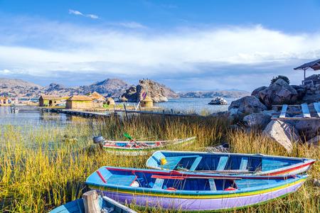 Colorful boats near floating islands on Lake Titicaca near Copacabana, Bolivia