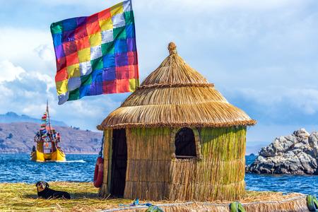 Whiphala flag on a hut on a floating island on Lake Titicaca near Copacabana, Bolivia photo