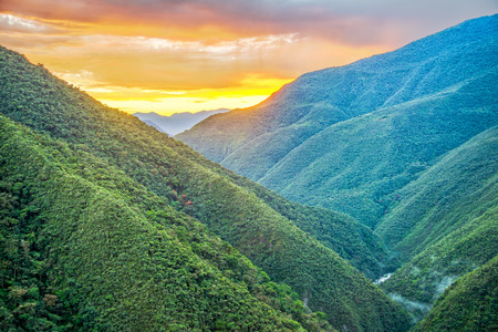 Sunrise of lush green jungle covered hills in Cotopata National Park near Coroico, Bolivia