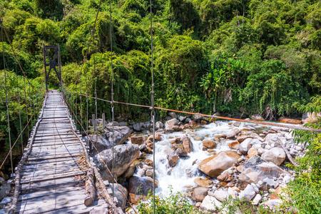 Small suspension bridge in the jungle near Coroico, Bolivia