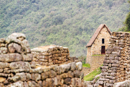 intact: View of a building with an intact roof at the ruins of Machu Picchu, Peru