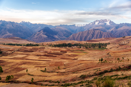 sacred valley of the incas: View of fields in the Sacred Valley near Cusco, Peru with Andes mountains rising over it