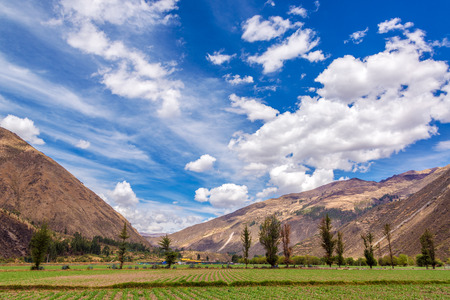 sacred valley of the incas: View of lush green fields in the Sacred Valley near Cusco, Peru Stock Photo
