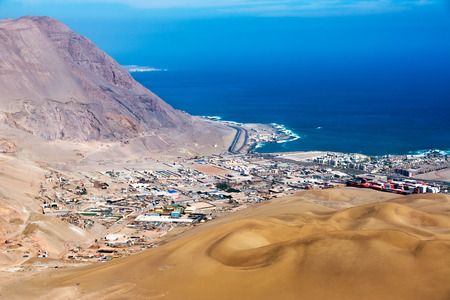 atacama: View of Iquique, Chile with sand dunes and Pacific Ocean visible