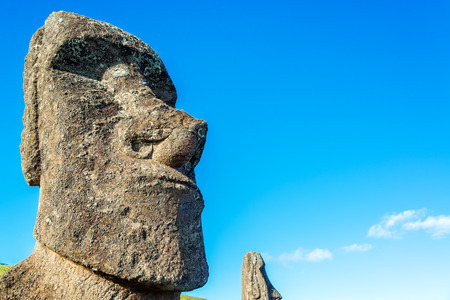 rano raraku: Closeup of a Moai statue with a smaller one in the background on Easter Island