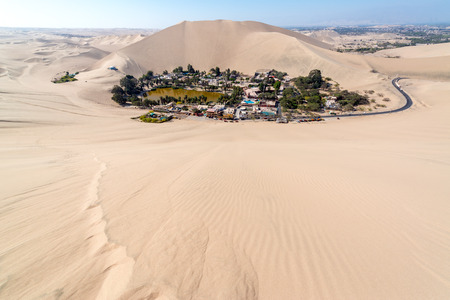 Hucachina oasis and sand dunes near Ica, Peru Stock Photo