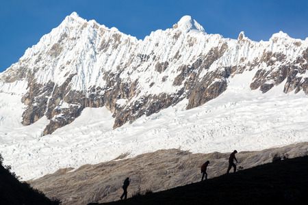 blanca: Hikers silhouetted against the Cordillera Blanca, part of the Andes mountains near Huaraz, Peru