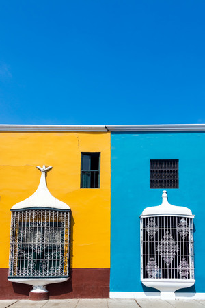 peru architecture: Historic yellow and blue architecture in Trujillo, Peru with a beautiful sky