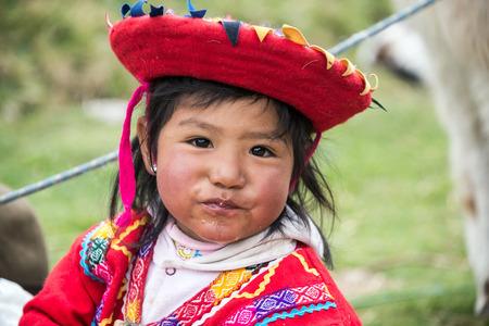 incan: CUZCO, PERU - SEPTEMBER 29: Young girl of Incan descent near Cuzco, Peru on September 29, 2014